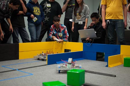High school students compete in the annual Pioneers in Engineering robotics competition.