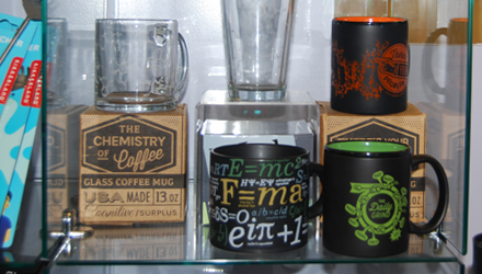 various mugs with science themed logos