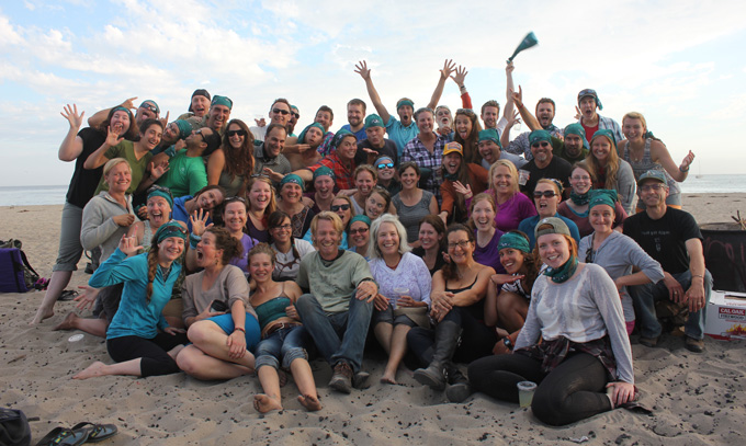 Beetles: Outdoor Educators group celebrating on a beach