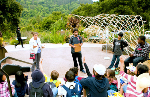 A teacher speaks to a group of students