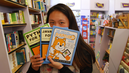 Connie holds up three books