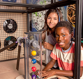 Two happy young people experimenting at the Wind Works station
