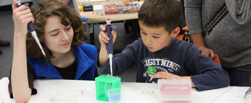 Two children conducting a science experiment in the Biotech lab