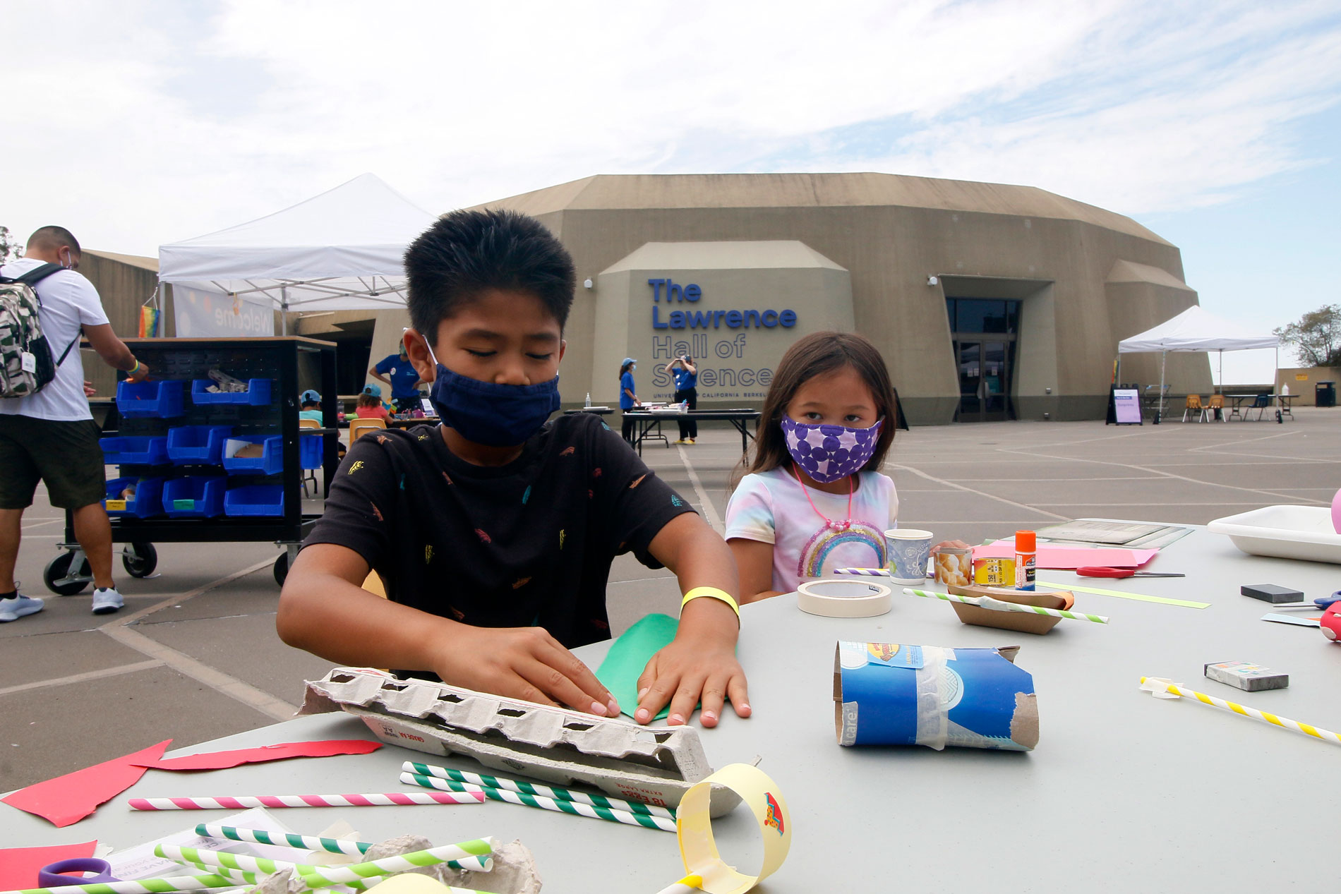Two children constructing paper sculptures during Summer Fundays at The Lawrence