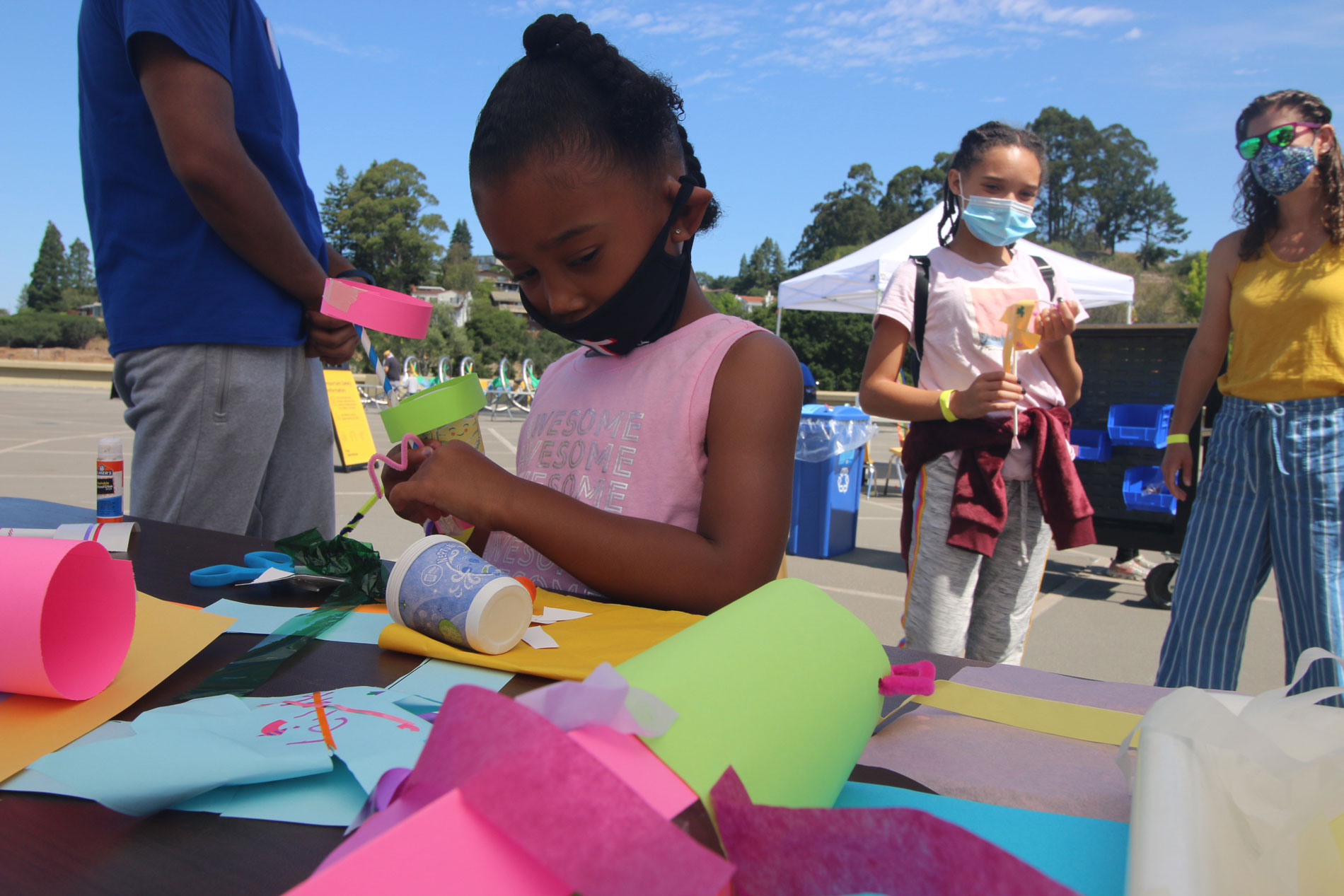 A child constructing a paper sculpture during Summer Fundays at The Lawrence