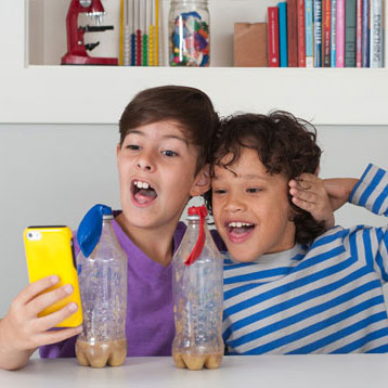 Two children looking at a science app