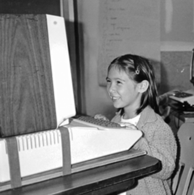 Staff member on computer when she was young